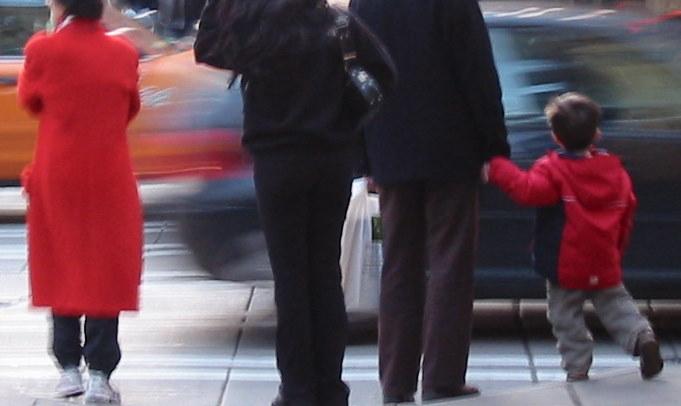 Four pedestrians waiiting to cross traffic